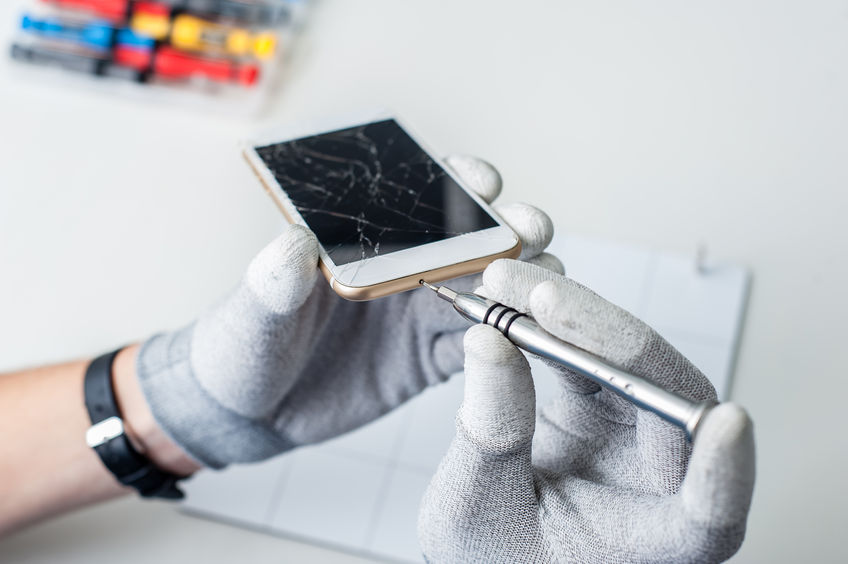 46987685 - close-up photos showing process of mobile phone repair